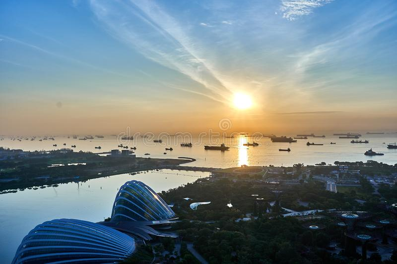 View of the Gardens by the Bay and the Flower Dome during sunrise. A view of the Gardens by the Bay and the Flower Dome during sunrise stock photo