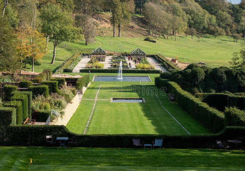 View of the gardens and the wider Somerset landscape from boutique hotel The Newt in Somerset, UK. Croquet lawn in the foreground stock photography