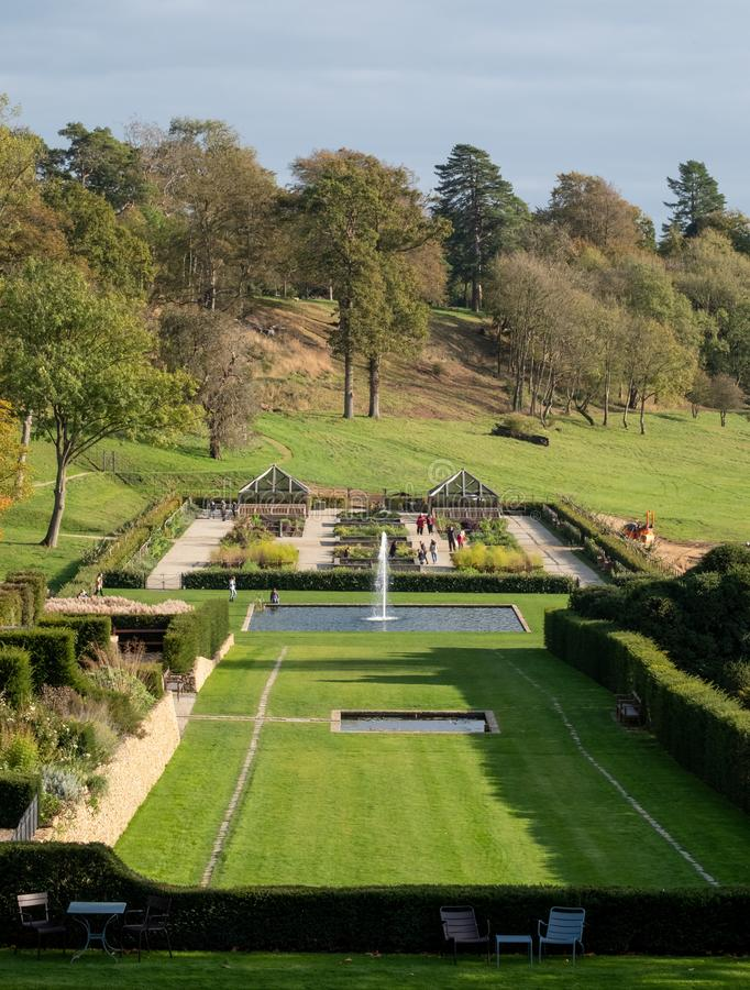 View of the gardens and the wider Somerset landscape from boutique hotel The Newt in Somerset, UK. Croquet lawn in the foreground royalty free stock photo