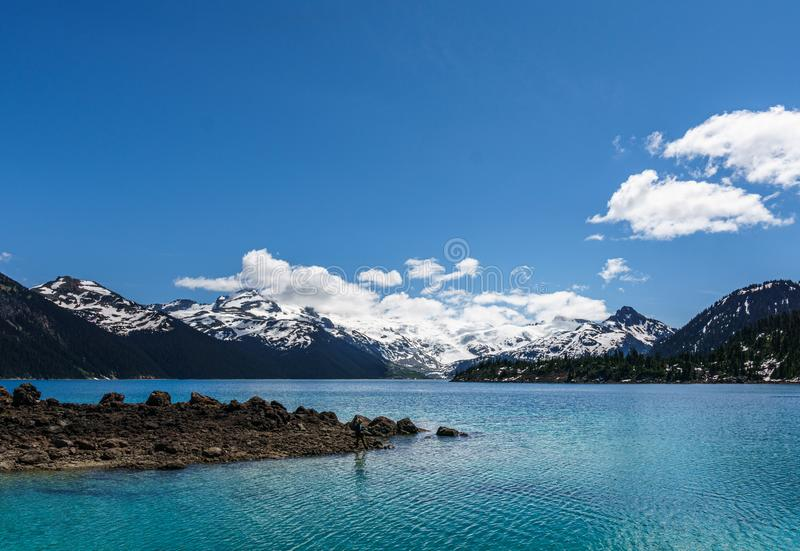 View at Garibaldi lake beautiful sunny morning with clouds on bluew sky. Landscape, mountain, scenery, scenic, water, nature, park, travel, outdoor, british royalty free stock photos