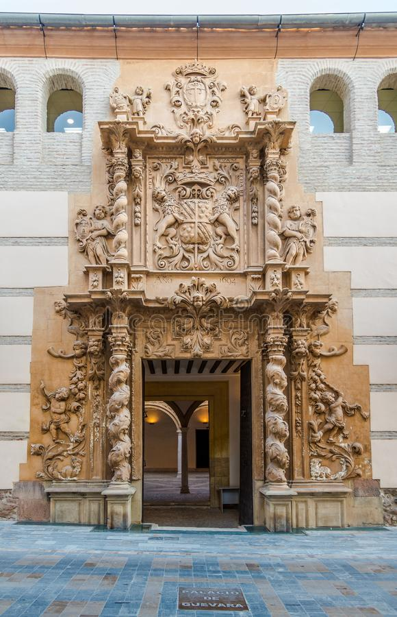 View at the gate to Palace of Guevara in Lorca - Spain. LORCA,SPAIN - OCTOBER 3,2017 - View at the gate to Palace of Guevara in Lorca. The town is situated in stock photos