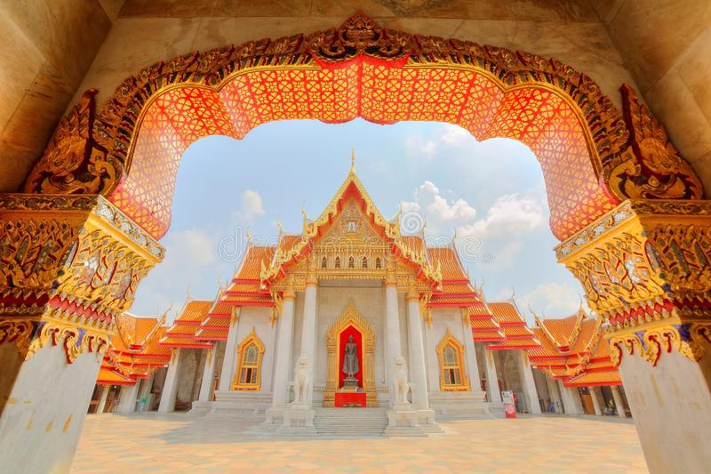 View through the gate to Wat Benchamabophit or The Marble Temple in Bangkok royalty free stock photography