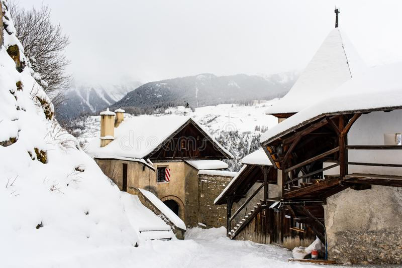 Ancient Swiss mountain chateau in snowy landscape royalty free stock images
