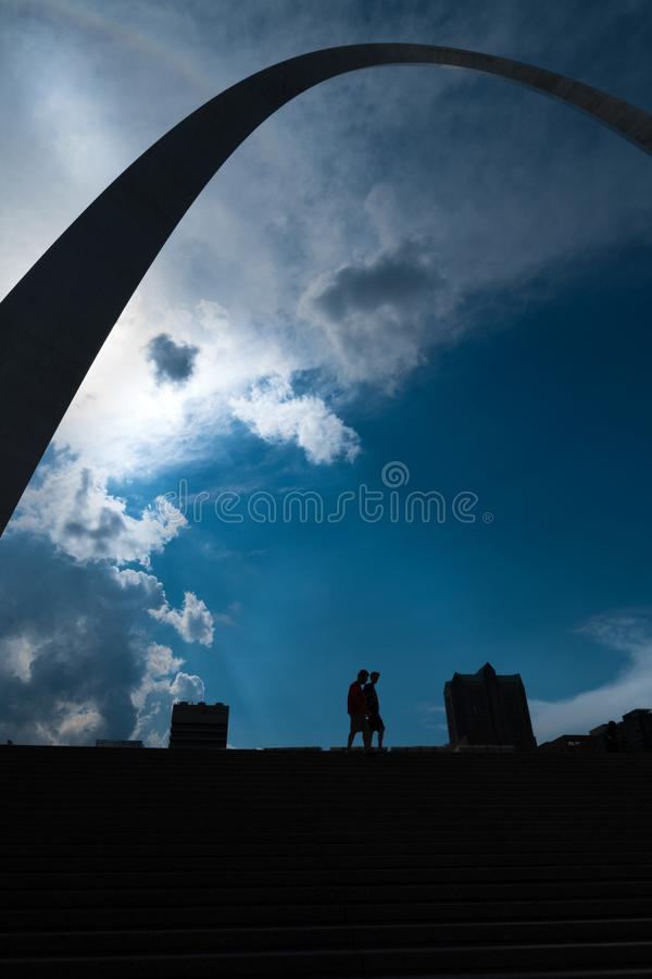 A Silhouette perspective of the gate way arch in st louis misouri. A view of the Gateway arch in ST. Louis Misouri. The arch was designed to represent the royalty free stock images
