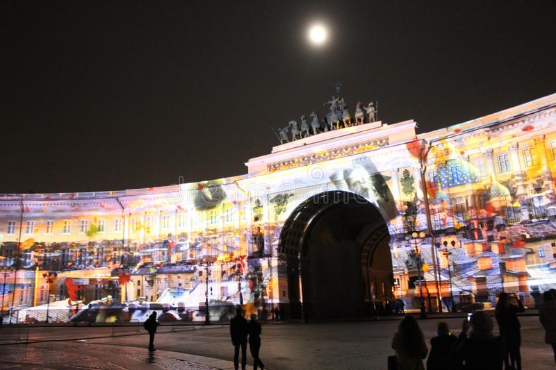 View of the General Staff Arch during the celebration of the city holiday Festival of Lights. View of the General Staff Arch in Saint-Petersburg during the royalty free stock image