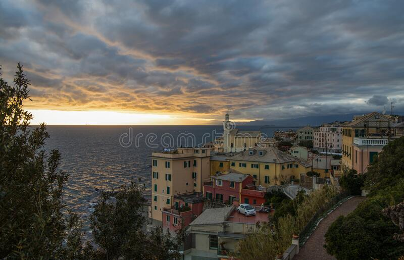 View of Genova Boccadasse under a cloudy sky at sunset, Italy stock image