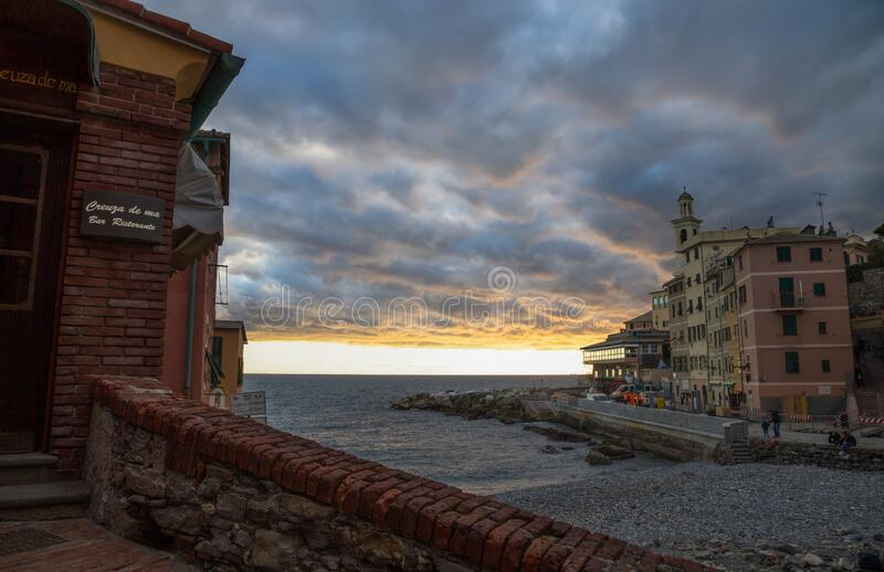 View of Genova Boccadasse under a cloudy sky at sunset, Italy royalty free stock photos