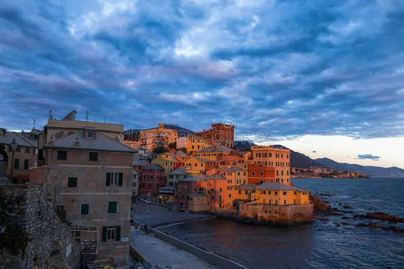 View of Genova Boccadasse under a cloudy sky at sunset, Italy stock images