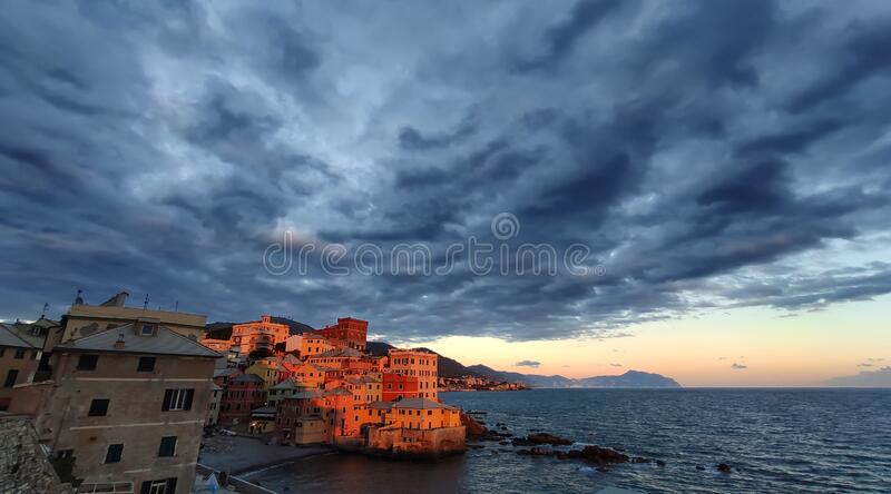 View of Genova Boccadasse under a cloudy sky at sunset, Italy stock photos