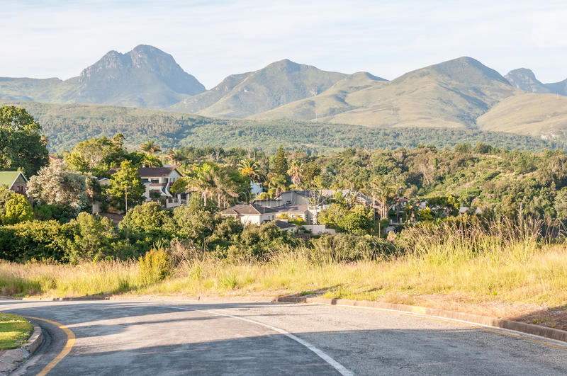 View of George in South Africa. GEORGE, SOUTH AFRICA - JANUARY 4, 2015: View of one of the suburbs in George with the Outeniqua Mountains in the back stock photography