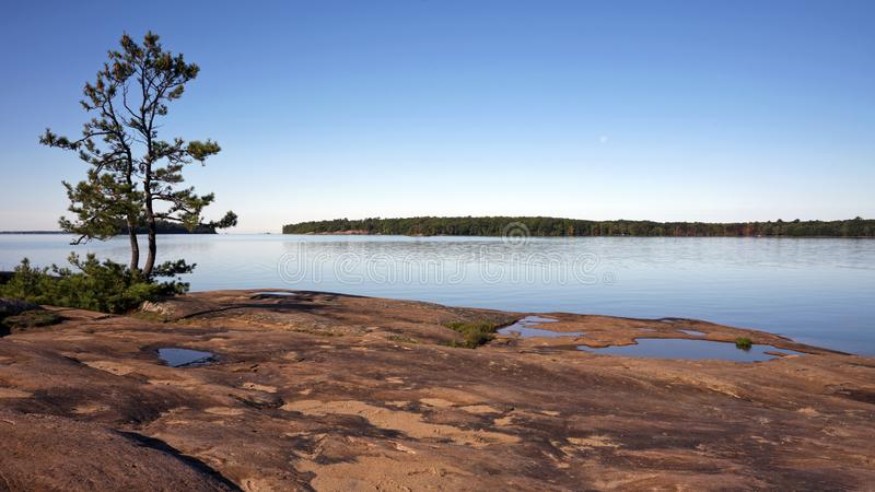 Morning light at Killbear Provincial Park, Ontario Canada. A view of Georgian Bay from a granite outcrop in Killbear Provincial Park, Ontario. This area is part stock photos