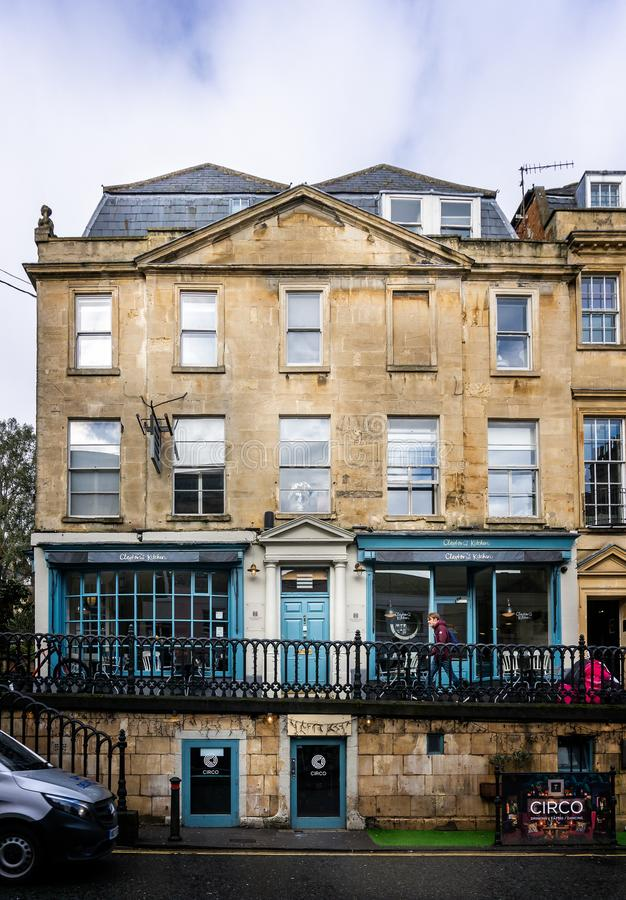 View of Georgian building with cafe on raised walk way on George Street, Bath, Somerset, UK. On 4 February 2019 stock photos