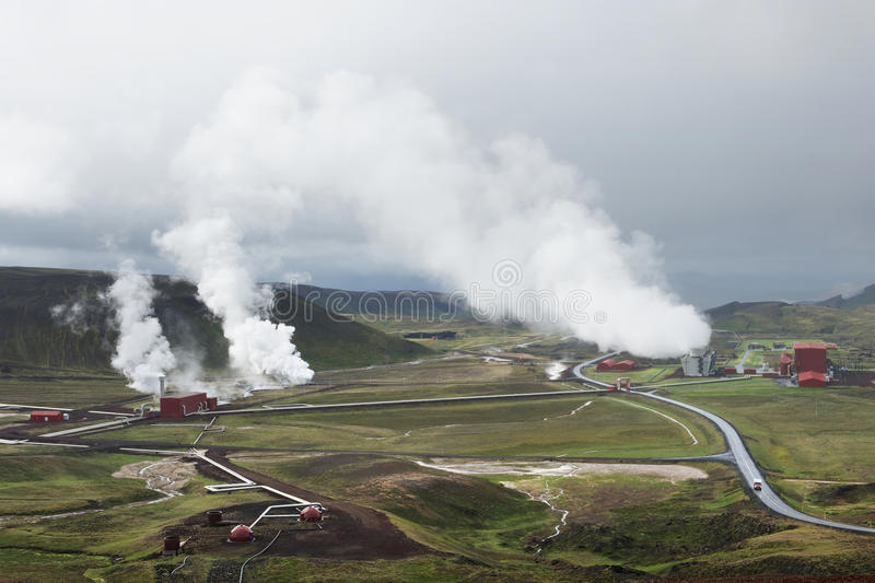 View of the geothermal power station at Krafla, Iceland. View of the geothermal power station with hot steam raising to the clouds, Krafla, Iceland royalty free stock photos