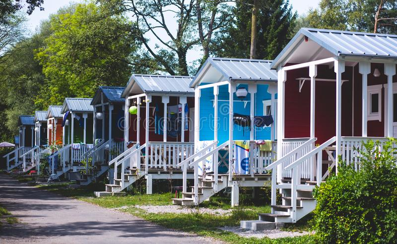 View of german camping place with tents, caravans, trailer park and cabin cottage houses. Germany royalty free stock photo
