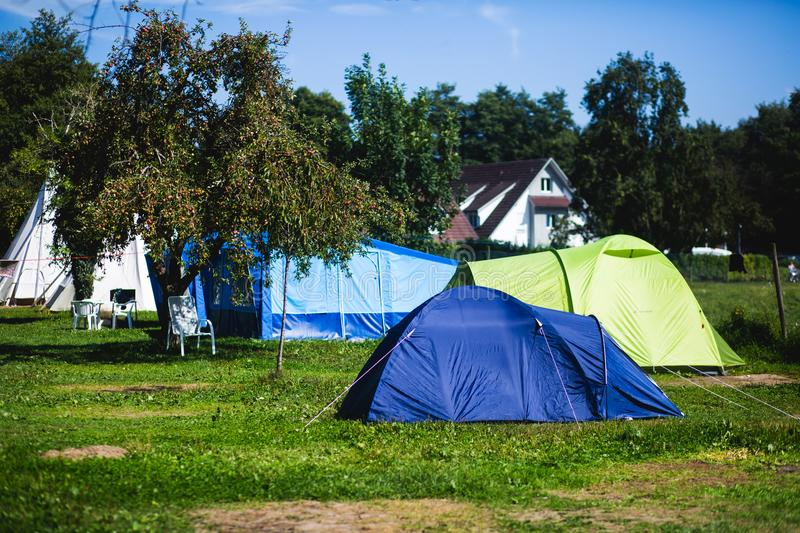 View of german camping place with tents, caravans, trailer park and cabin cottage houses. Germany royalty free stock images