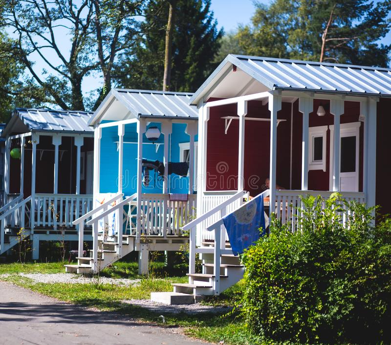 View of german camping place with tents, caravans, trailer park and cabin cottage houses. Germany royalty free stock image