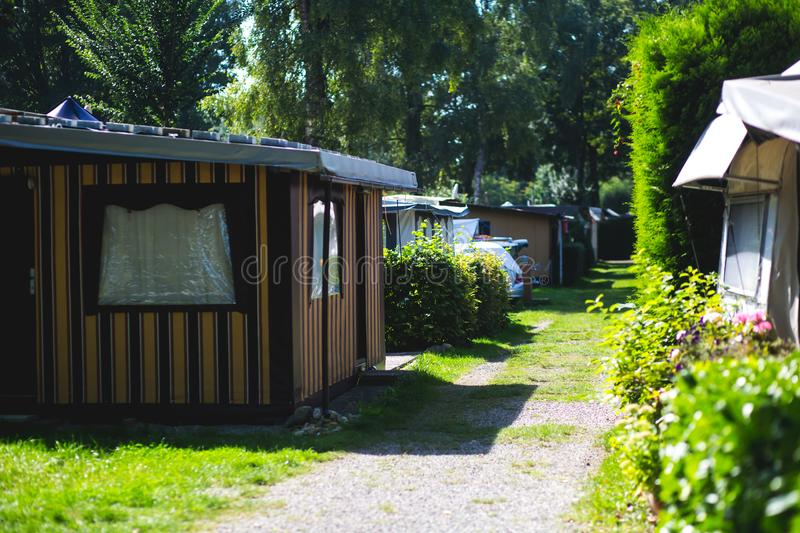 View of german camping place with tents, caravans, trailer park and cabin cottage houses. Germany stock images