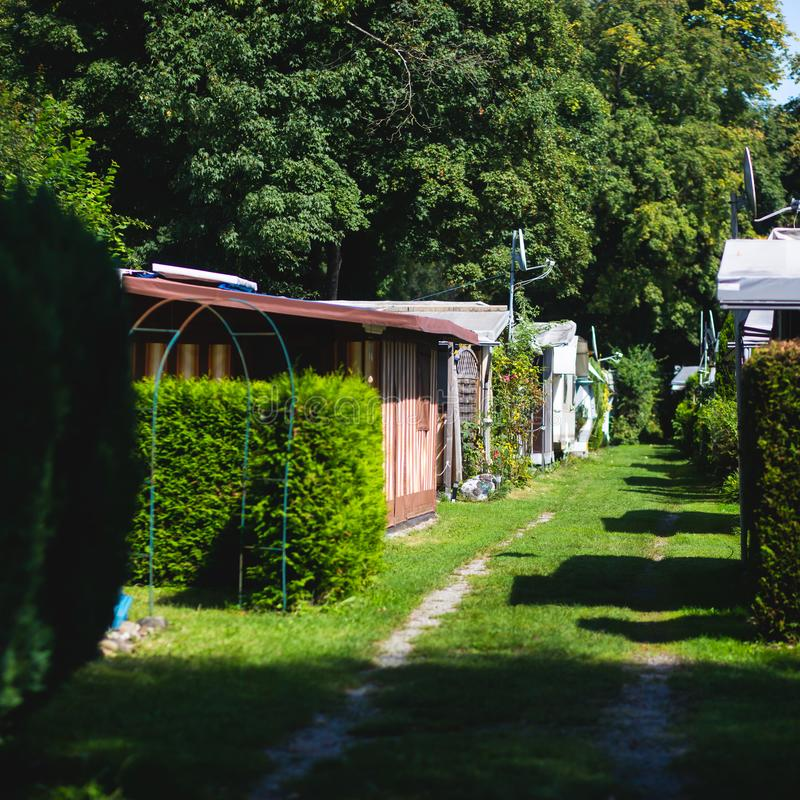 View of german camping place with tents, caravans, trailer park and cabin cottage houses. Germany royalty free stock photos