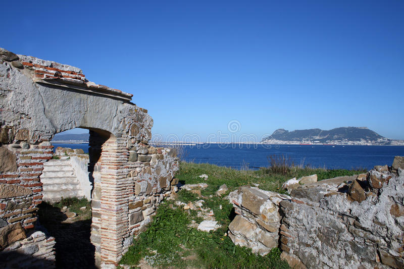 View of Gibraltar from Algeciras. A view of Gibraltar from a ruined fort in Punta San Garcia, in the Parque del Centenario, a nature reserve on the outskirts of stock images