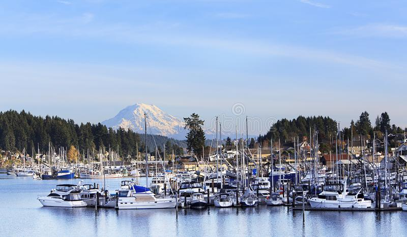 Gig Harbor Washington State Mt. Rainier. A view of Gig Harbor, a small town located on the Puget Sound of the Pacific Northwest of Washington state, with fishing royalty free stock photos