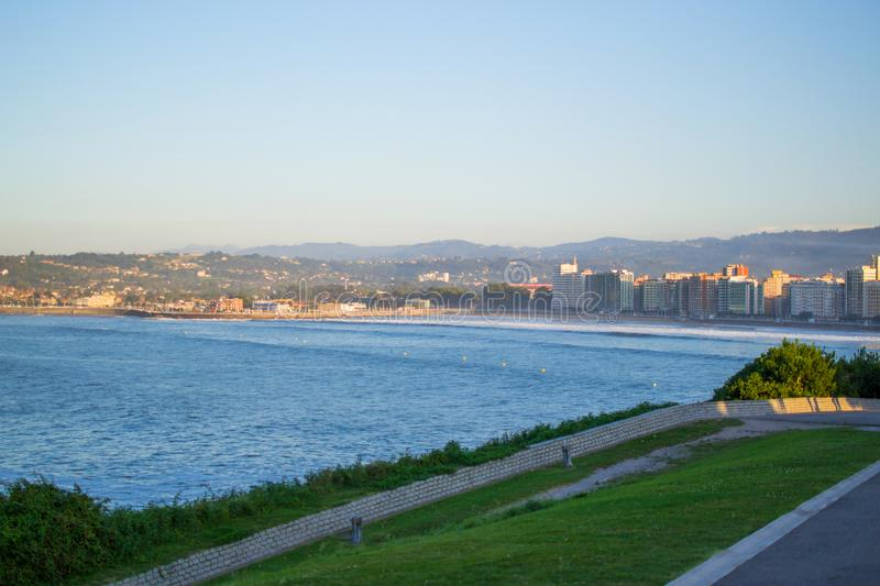 View of Gijon and Cantabrian Sea from Cerro de Santa Catalina, in Asturias, Spain. Green park and hill.  stock photos
