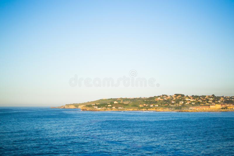 View of Gijon and Cantabrian Sea from Cerro de Santa Catalina, in Asturias, Spain. Green park and hill.  royalty free stock photography