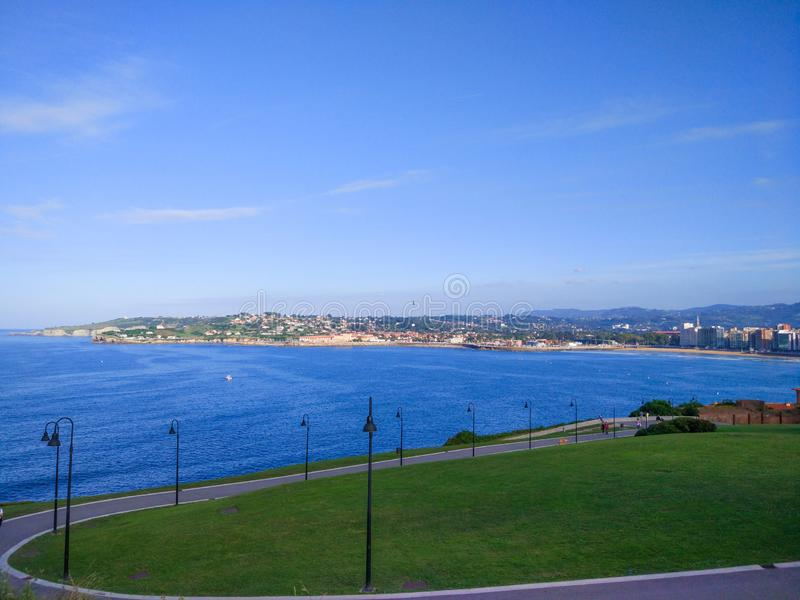 View of Gijon and Cantabrian Sea from Cerro de Santa Catalina, in Asturias, Spain. Green park and hill.  stock photography