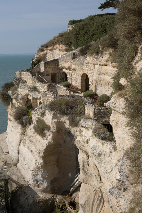 View from the Gironde estuary with the limestone cliff. Of the village of Meschers sur Gironde and its troglodytic houses and traditionnal typical wooden stock photography