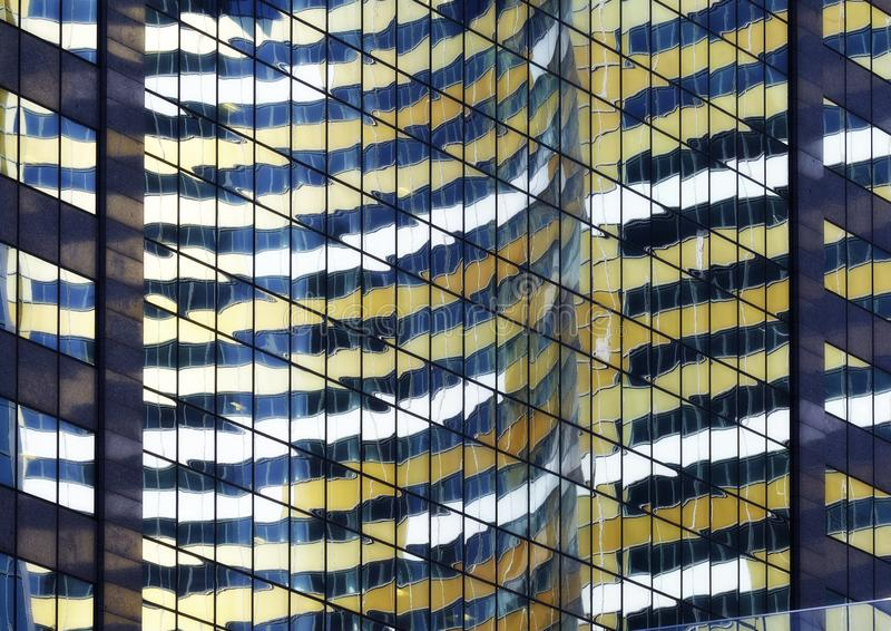 Glass skyscraper windows pattern with reflections. View of glass skyscraper windows pattern with reflections royalty free stock photo