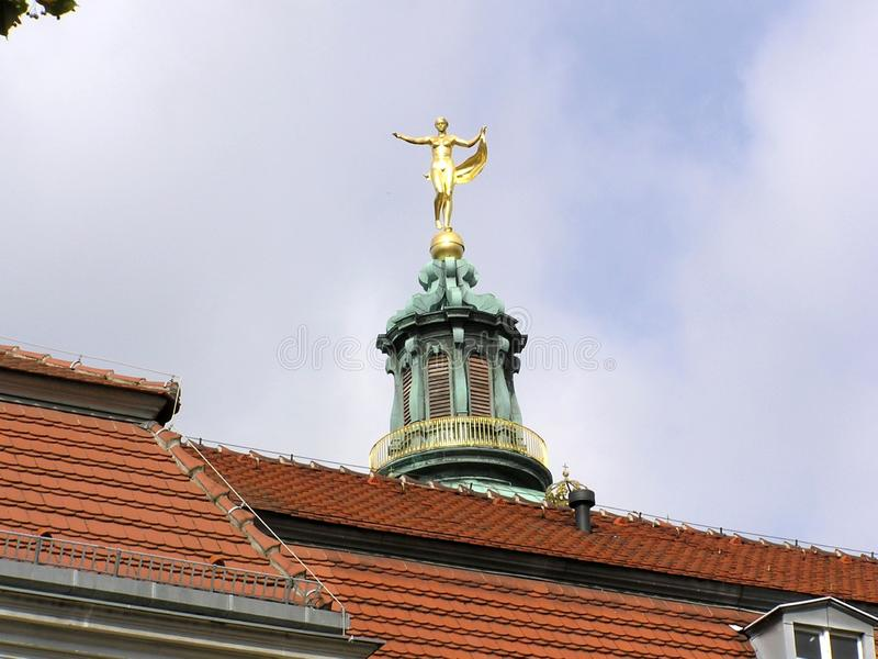 Gold statue on the roof. View of Gold statue on the roof of ancient castle in Berlin germany royalty free stock photography