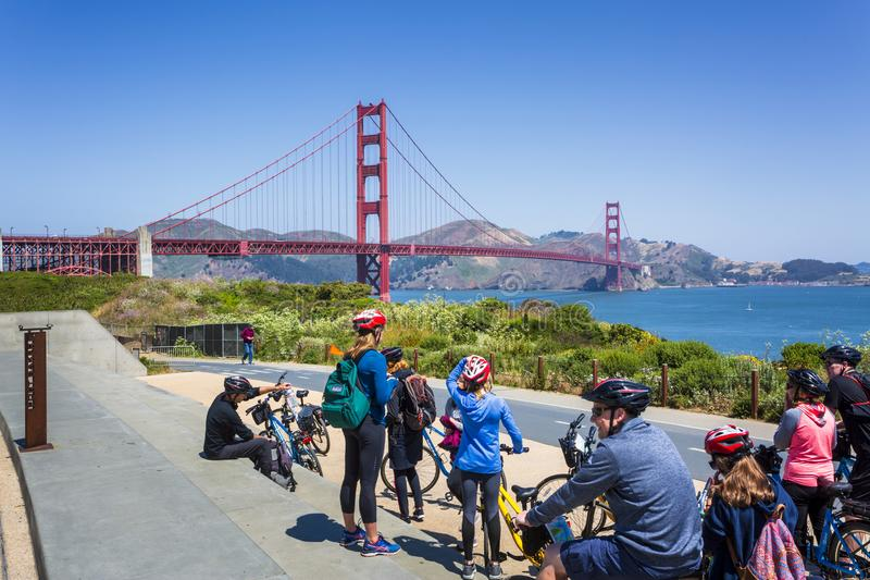 View of Golden Gate Bridge and cyclists, San Francisco, California, USA, North America stock image
