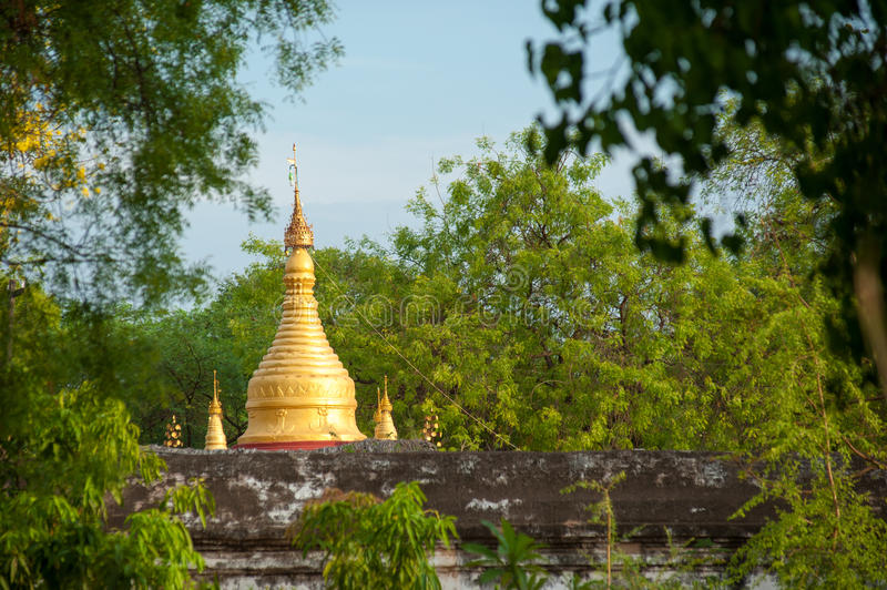 View of the golden Kuthodaw Pagoda in Mandalay stock images