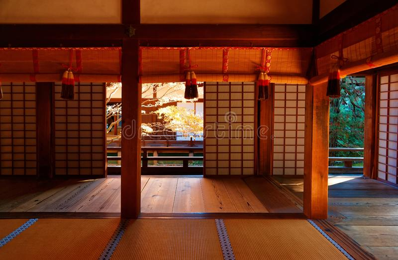 View of golden maple foliage in the courtyard garden behind the sliding screen doors Shoji of a Japanese architecture royalty free stock photo