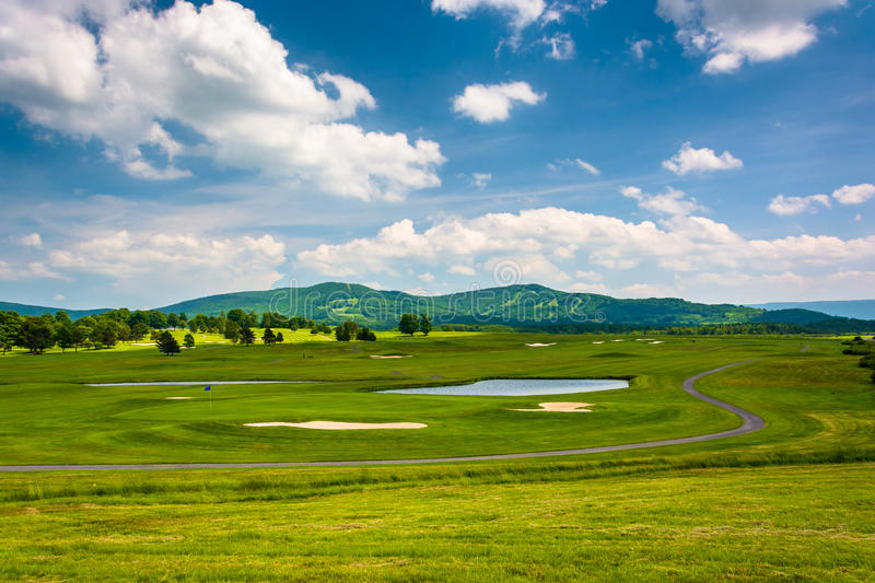 View of a golf course and distant mountains at Canaan Valley Sta royalty free stock images