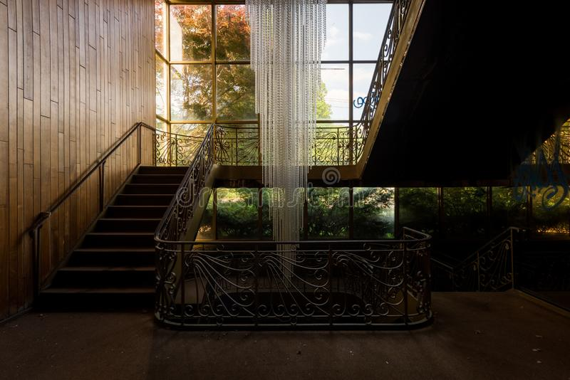 Mid-Century Style Chandelier and Staircase - Abandoned East Nassau Hebrew Synagogue - New York. A view of gorgeous Mid-Century style chandelier and staircase royalty free stock photography