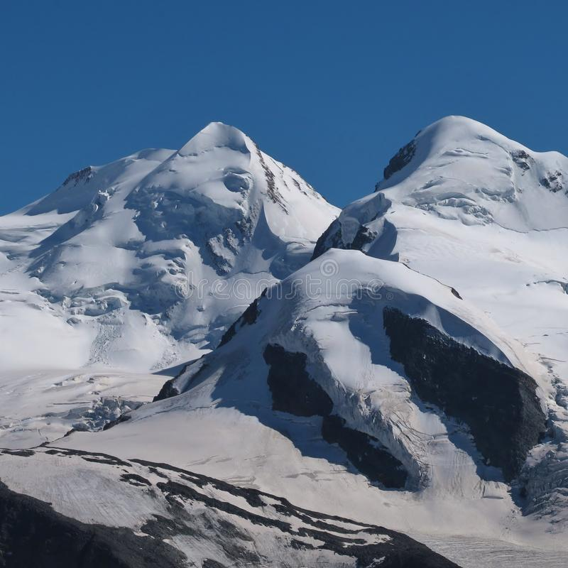 View from Gornergrat, Zermatt. High mountains covered by glaciers royalty free stock photo