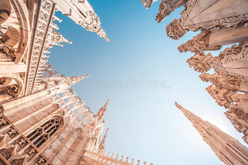 view of Gothic architecture and art on the roof of Milan Cathedral (Duomo di Milano), Italy royalty free stock photos