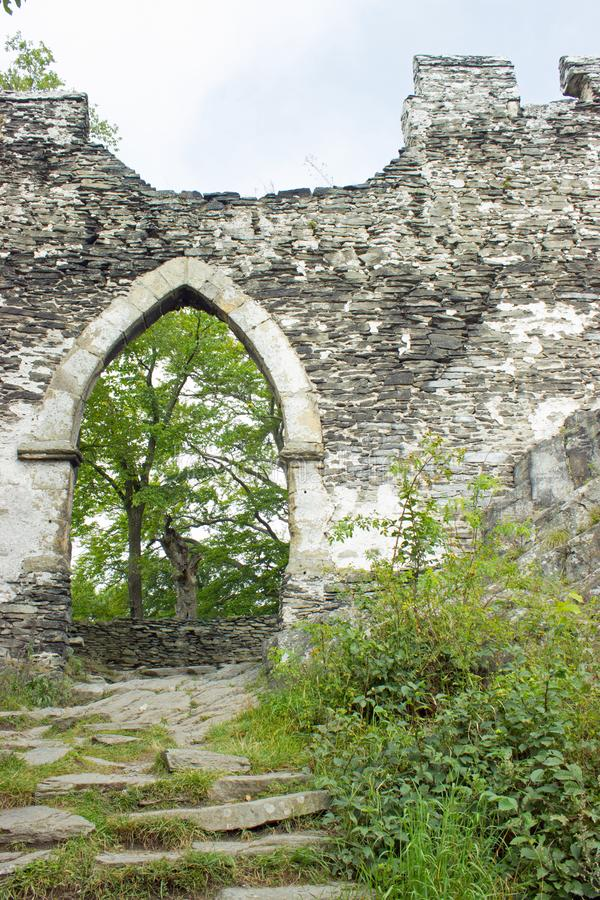 View of gothic gate with walls, path with stairs royalty free stock photo