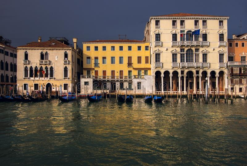 View of the Gran Canal. The beauty of old Venice. Sunset in Italy. Reflection of colored facades stock image