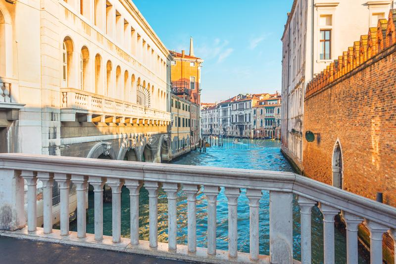 View of the Grand Canal in Venice from a small marble pedestrian bridge.  royalty free stock image