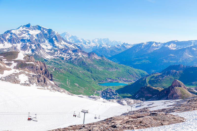 View from the Grande Motte glacier. At Tignes, lake, mountains and Mont Blanc. French Alps stock photos