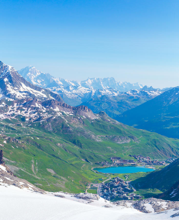 View from the Grande Motte glacier at Tignes. Lake, mountains and Mont Blanc. French Alps stock image