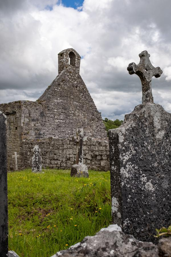 A view through grave stone of the abanoned ruins of Killone Abbey that was built in 1190 and sits on the banks of the Killone Lake. Just outside Ennis, County royalty free stock photos