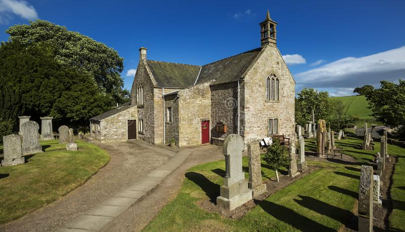 A view of the graveyard and church building in Aberlemno in Angus, Scotland royalty free stock image