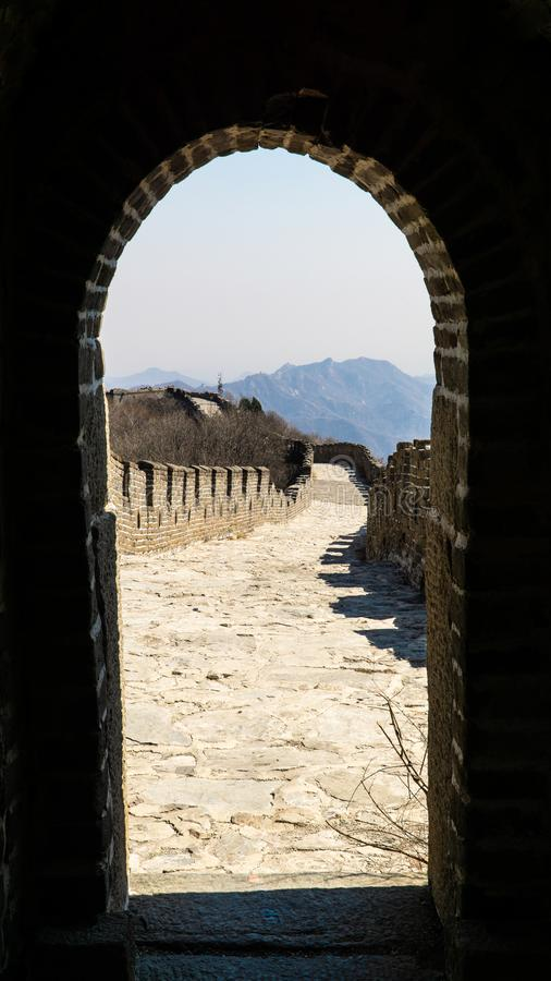 View of Great Wall of China through the brick rounded door leading from watchtower, China. stock photography
