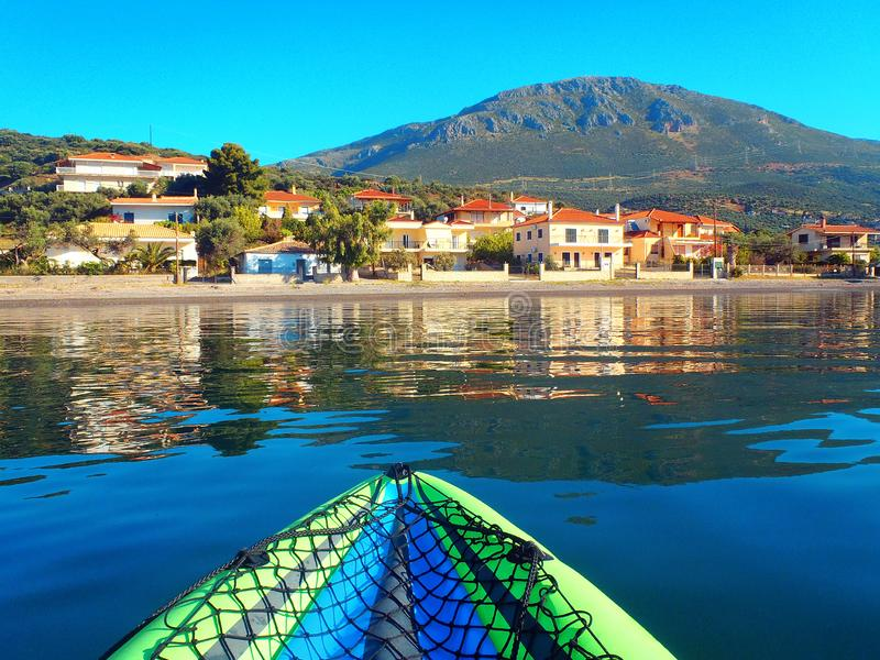 View of Greek Mountain and Fishing Village Reflected in Gulf of Corinth Water stock photo