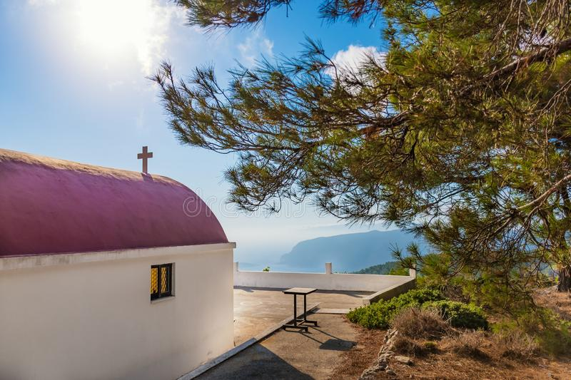 View of Greek orthodox church with cyclamen roof next to forest Rhodes, Greece stock images