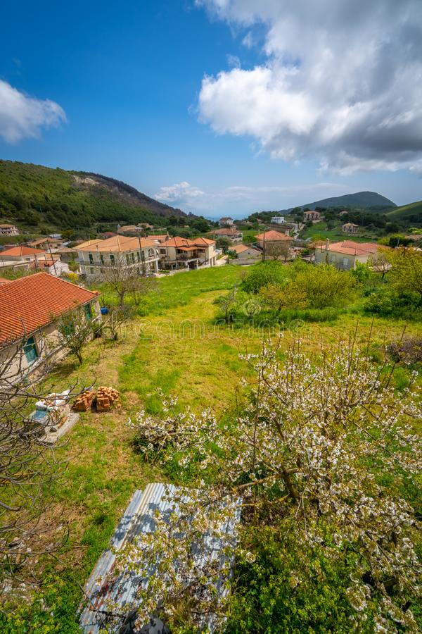 Agios Leon village homes in Zante. View of the green countryside of the interior of Zante or Zakynthos Island with red tiled rooftops of homes in Agios Leon royalty free stock photos