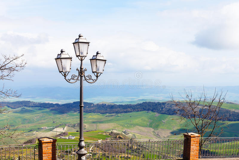 View of green sicilian lands from Aidone town. View of green sicilian lands in spring from Aidone town, Italy royalty free stock image