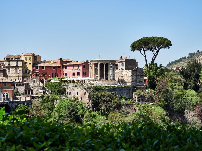 View from green Villa Gregoriana park of cute antique Roman temple in Tivoli April 25, 2018 Tivoli, Italy - EUrope royalty free stock images
